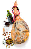 Ham, wine, olives and nuts Royalty Free Stock Photos