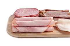 Ham in wooden plate Stock Photos