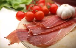 Ham3. Dried ham in a slices on a wooden plate Royalty Free Stock Photo