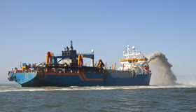 HAM316. A Trailing suction hopper Dredger at Work stock photography