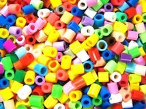 Hama Beads. Multi colored hama bead toy Stock Photo