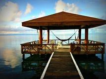 Hamac donnant sur la mer Photographie stock libre de droits