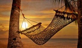 Hamaca de la puesta del sol Imagen de archivo libre de regalías