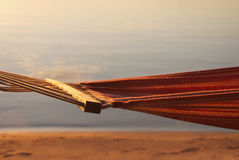 Hamaca delante de la puesta del sol Imagen de archivo