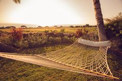 Hamaca en la puesta del sol Foto de archivo libre de regalías
