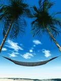 Hamaca entre los palmtrees Imágenes de archivo libres de regalías