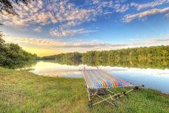 Hamaca por un lago Imágenes de archivo libres de regalías
