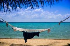 Hamaca y mar Imagen de archivo libre de regalías