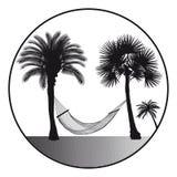 Hamaca y palmeras Imagenes de archivo