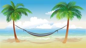 Hamaca y palmeras en la playa Imagen de archivo libre de regalías