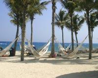 Hamacas en la playa Fotos de archivo libres de regalías