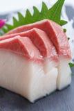 Hamachi Sashimi : Sliced Raw Hamachi Yellowtail Fish Served with Sliced Radish on Stone Plate.  Royalty Free Stock Images