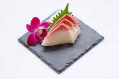 Hamachi Sashimi : Sliced Raw Hamachi Yellowtail Fish Served with Sliced Radish on Stone Plate.  Royalty Free Stock Photo
