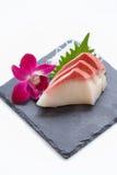 Hamachi Sashimi : Sliced Raw Hamachi Yellowtail Fish Served with Sliced Radish on Stone Plate.  Stock Photography