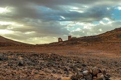 Hamada du Draa, moroccan stone desert in foreground, mountains in background, Morocco. Hamada du Draa, Moroccan stone desert at dawn in the foreground, mountains royalty free stock photo