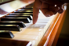 Haman hand playing piano. Royalty Free Stock Photos