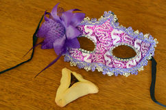 Hamantaschen cookie and Purim mask. Hamantaschen cookie and Purim jewish holiday carnival mask. Holiday concept. copy space Stock Photo