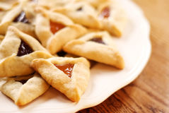 Hamantaschen Cookies. Traditional hamentaschen cookies with raspberry and apricot filling for the Jewish festival of Purim Royalty Free Stock Image