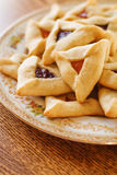 Hamantaschen Cookies. Traditional hamentaschen cookies with raspberry and apricot filling for the Jewish festival of Purim Stock Images