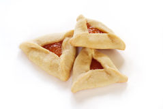 Hamantaschen Cookies. Traditional hamentaschen cookies with apricot filling for the Jewish festival of Purim Royalty Free Stock Photos