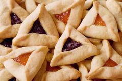 Hamantaschen Cookies. Traditional hamentaschen cookies with raspberry and apricot filling for the Jewish festival of Purim Stock Image