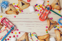 Hamantaschen cookies and candy background. View from above Stock Photography