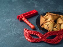 Hamantaschen cookies with carnival mask Royalty Free Stock Photos