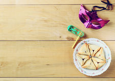 Hamantaschen cookies or hamans ears and mask for Purim celebration (jewish holiday) Royalty Free Stock Photography