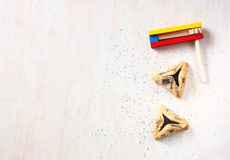 Hamantaschen cookies or hamans ears for Purim celebration and noisemaker Royalty Free Stock Photo
