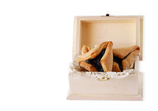 Hamantaschen cookies or hamans ears for Purim celebration in wooden box isolated Royalty Free Stock Images