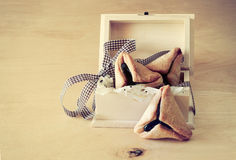 Hamantaschen cookies or hamans ears for Purim celebration in wooden box. vintage effect. Royalty Free Stock Photos