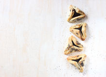 Hamantaschen cookies or hamans ears for Purim holiday celebration . top view. Stock Photos