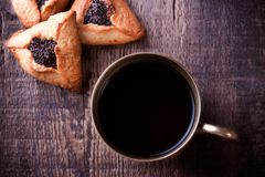 Hamantaschen cookies for Purim and coffee in Stock Photos