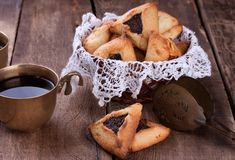 Hamantaschen cookies for Purim and coffee in Royalty Free Stock Image