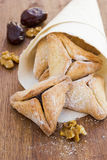 Hamantaschen cookies for Purim on a wooden surface Royalty Free Stock Photos