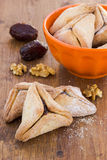Hamantaschen cookies for Purim on a wooden surface Stock Photography