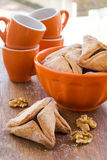 Hamantaschen cookies for Purim on a wooden surface Royalty Free Stock Photo