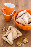 Hamantaschen cookies for Purim on a wooden surface Royalty Free Stock Images