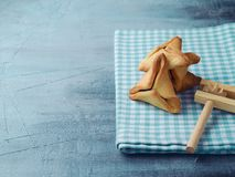 Hamantaschen cookies on tablecloth Stock Image