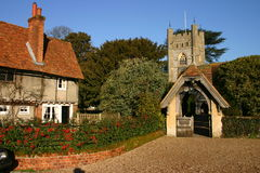 Hambleden Village And Church. Rustic cottage and Church Entrance Porch in the Buckinghamshire village of Hambleden UK Stock Photo