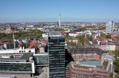 Hamburg air view. Aerial view of the city of hamburg with blue sky, modern office buildings in front and TV tower in background Royalty Free Stock Images