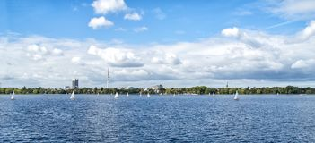 Hamburg Alster Skyline With TV Tower On The Horizon And Sailing Ships On The Water - Panoramic View royalty free stock photography