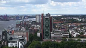 Hamburg Atlantic house aerial. Aerial view of Hamburg harbour and the St. Pauli hotel and office buildings, with the Atlantic house in the center stock footage