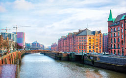 Hamburg city canal and red brick buildings Royalty Free Stock Image