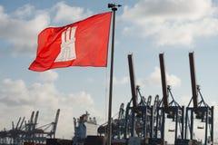 Hamburg city flag on harbor cranes background Royalty Free Stock Photography
