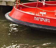 Hamburg city name sign on a red ship stern Royalty Free Stock Photo
