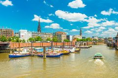 Hamburg cityscape. View of the canal with colored boats royalty free stock photography