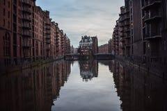 Hamburg classics reflection. The beautiful Wasserschlösschen Speicherstadt and a lot calmed water royalty free stock images