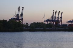 Hamburg - Container gantry cranes in the evening. Container gantry vranes in Hamburg-Waltershof taken in the evening after the sun goes down Royalty Free Stock Photography