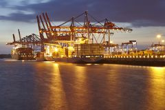 Hamburg - Container terminal in the evening Stock Photos